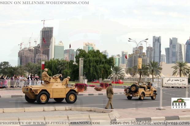 A Qatar Armed Forces Ferret Mk2 armoured car & an Austin Champ vehicle.