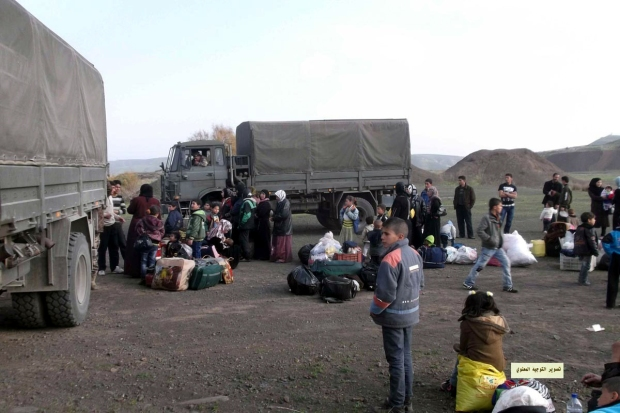 Royal Jordanian Land Force DAF YA-4442 trucks next to Syrian refugees in January 2013.