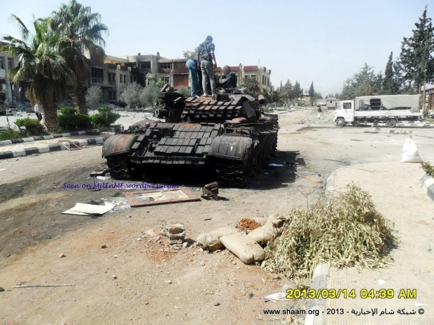 A burned out Syrian Army T-55AMV in Damascus, March 14, 2013.