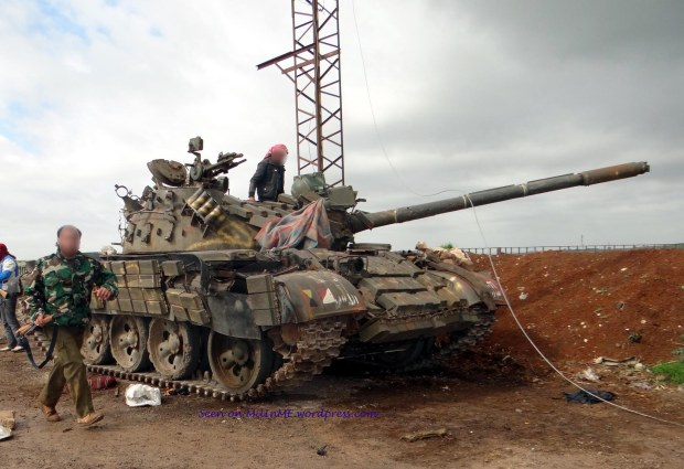 A knocked out Syrian Army T-55AMV at Zayzoun, Deraa, February 16, 2013.