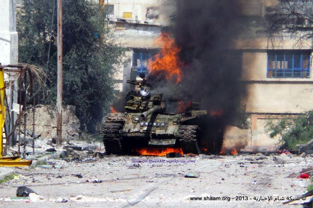 A burning Syrian Army T-55AMV in Deraa, March 9, 2013.