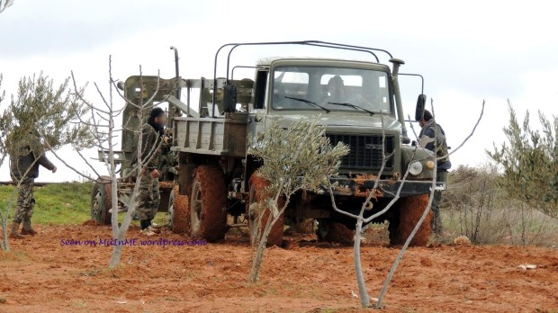 A captured Syrian Army Gaz-3308 Sadko truck towing a 57mm S-60 manned by its new owners, Taftanaz, Edleb, January 9, 2013.