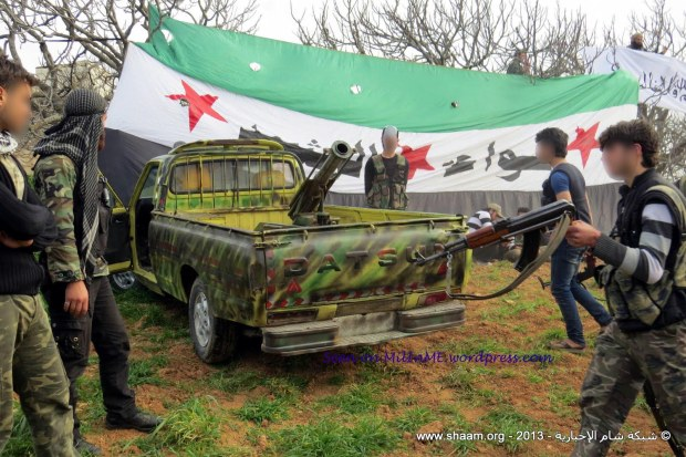 A Syrian Free Army Datsun pick up technical, A Syrian Free Army workshop refurbishing and modifying mortars and guns, Binish, Edleb, March 21, 2013.