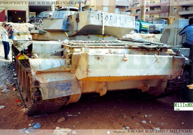 An ex SLA militia Tiran 55 parked as trophy in a yard, Southern Suburbs of Beirut, 2001.