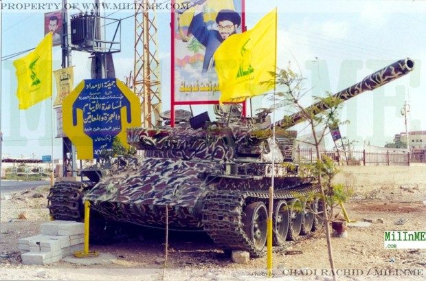 An ex SLA militia Tiran 55  tank memorial/trophy painted with an Iranian inspired camouflage in Southern Lebanon, 2002.